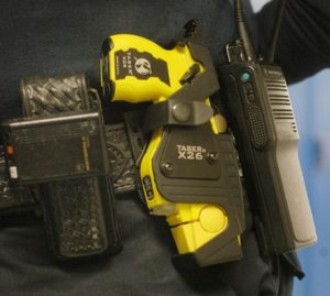 ** FILE ** In a file photo St. Paul police officer Julie Maidment wears her new yellow Taser gun at Highland Park Senior High School in St. Paul, Minn. Wednesday, Feb. 2, 2005. Stun gun maker Taser International Inc. on Wednesday, Oct. 26, 2005 reported a steep decline in third-quarter profit, hurt by slumping sales amid the ongoing controversy over the safety of its stun guns. (AP Photo/Janet Hostetter)