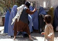 Taliban beating a woman in public