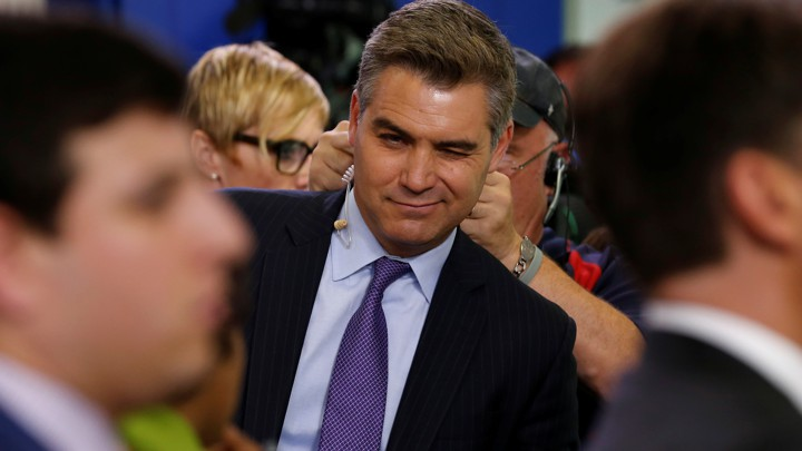 Acosta winks at a fellow reporter after the daily press briefing at the White House in Washington