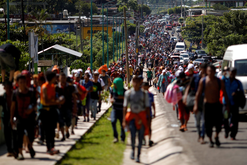 Central American migrants walk along the highway near the border with Guatemala, as they continue their journey trying to reach the U.S., in Tapachula, Mexico