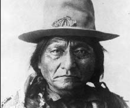Portrait of Sitting Bull, wearing an old hat.