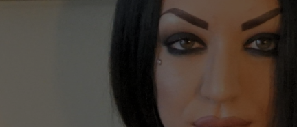 Partial extreme close up of womans face with seductive look and perfect makeup and eyebrows