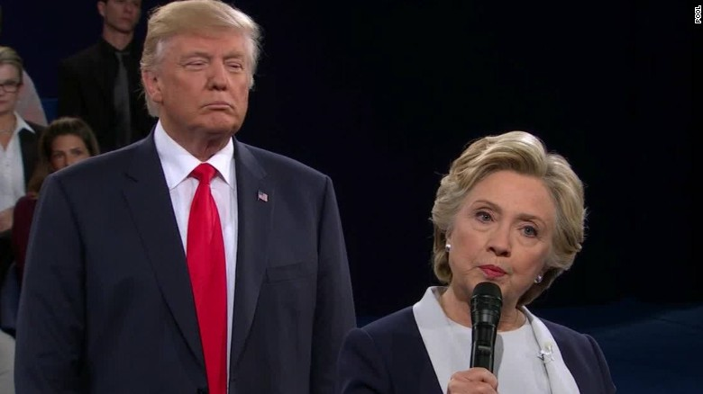 Trump looking over Hillary's shoulder at 2016 Presidential Debate